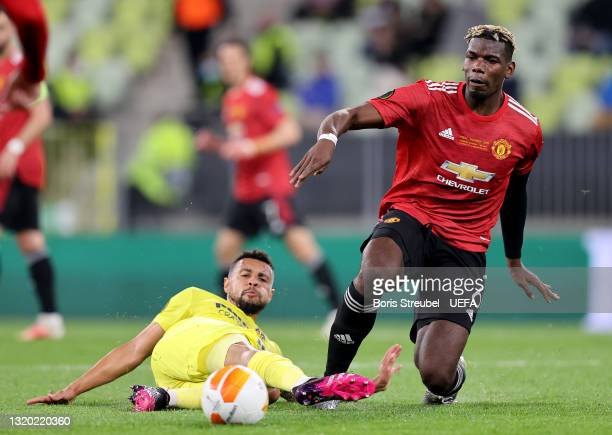 Paul Pogba of Manchester United is challenged by Francis Coquelin of Villarreal during the UEFA Europa League Final between Villarreal CF and...