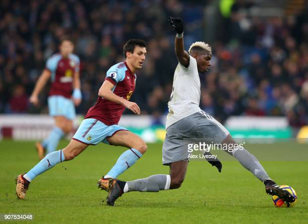 Paul Pogba of Manchester United is challenged by Jack Cork of Burnley during the Premier League match between Burnley and Manchester United at Turf...