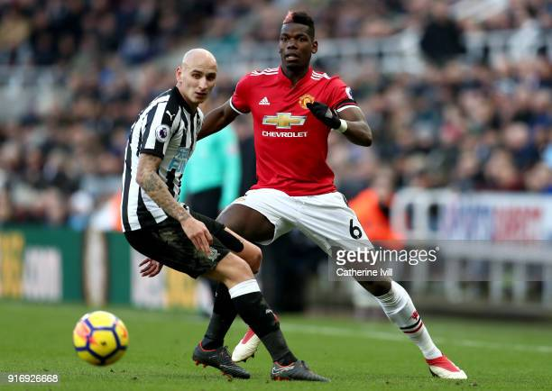 Paul Pogba of Manchester United is challenged by Jonjo Shelvey of Newcastle United during the Premier League match between Newcastle United and...