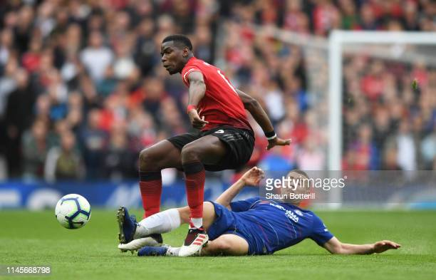 Paul Pogba of Manchester United is challenged by Mateo Kovacic of Chelsea during the Premier League match between Manchester United and Chelsea FC at...