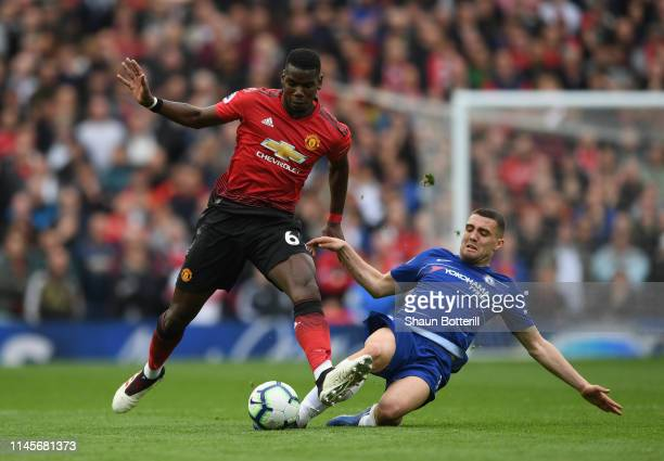Paul Pogba of Manchester United is challenged by Mateo Kovacic of Chelseaduring the Premier League match between Manchester United and Chelsea FC at...