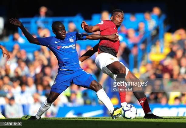 Paul Pogba of Manchester United is challenged by N'Golo Kante of Chelsea during the Premier League match between Chelsea FC and Manchester United at...