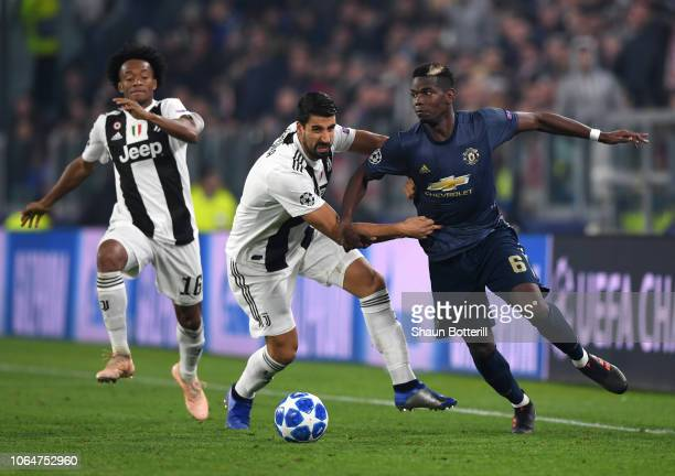 Paul Pogba of Manchester United is challenged by Sami Khedira of Juventus during the UEFA Champions League Group H match between Juventus and...