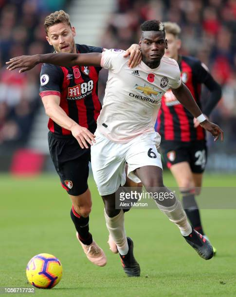 Paul Pogba of Manchester United is challenged by Simon Francis of AFC Bournemouth during the Premier League match between AFC Bournemouth and...
