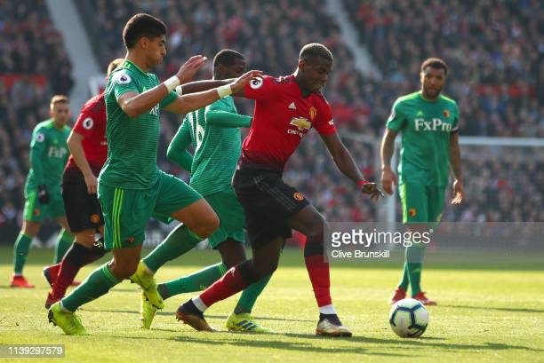 Paul Pogba of Manchester United is challenged during the Premier League match between Manchester United and Watford FC at Old Trafford on March 30...