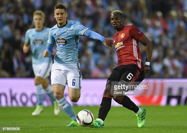 Paul Pogba of Manchester United is chased by Nemanja Radoja of Celta Vigo during the UEFA Europa League semi final first leg match between Celta Vigo...