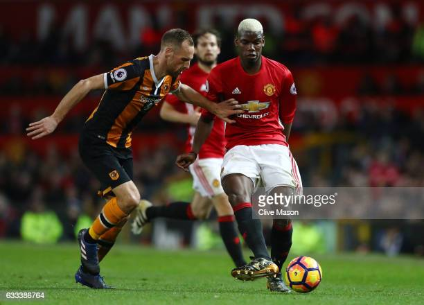 Paul Pogba of Manchester United is closed down by David Meyler of Hull City during the Premier League match between Manchester United and Hull City...