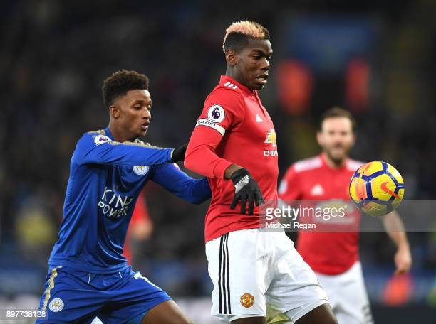 Paul Pogba of Manchester United is closed down by Demarai Gray of Leicester City during the Premier League match between Leicester City and...