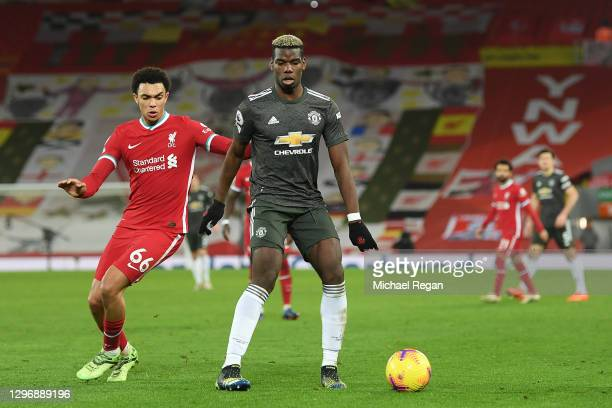 Paul Pogba of Manchester United is closed down by Trent Alexander-Arnold of Liverpool during the Premier League match between Liverpool and...