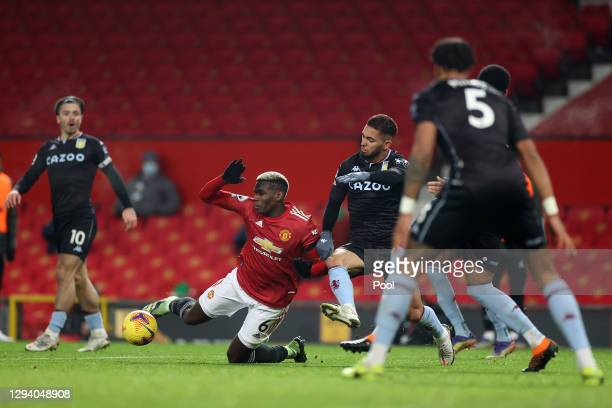 Paul Pogba of Manchester United is fouled by Douglas Luiz of Aston Villa leading to a penalty during the Premier League match between Manchester...