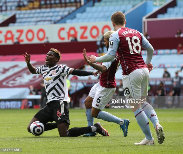 Paul Pogba of Manchester United is fouled by Douglas Luiz of Aston Villa to win a penalty during the Premier League match between Aston Villa and...