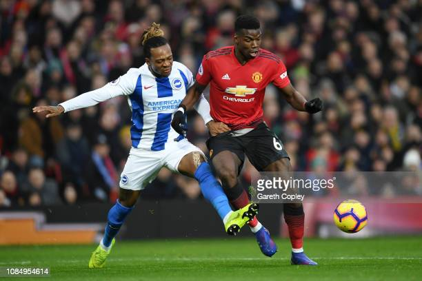 Paul Pogba of Manchester United is fouled by Gaetan Bong of Brighton and Hove Albion and a penalty is later given to Manchester United during the...