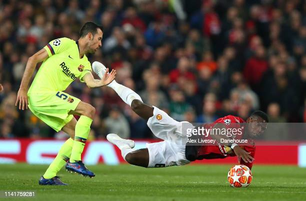 Paul Pogba of Manchester United is fouled by Sergio Busquets of FC Barcelona during the UEFA Champions League Quarter Final first leg match between...