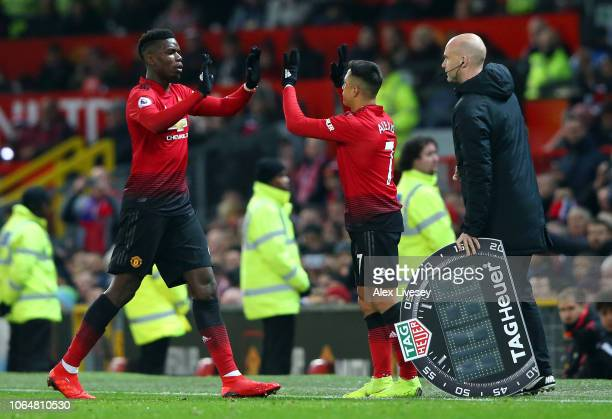 Paul Pogba of Manchester United is replaced by Alexis Sanchez of Manchester United during the Premier League match between Manchester United and...