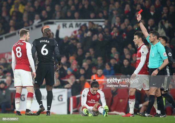 Paul Pogba of Manchester United is sent off by Referee Andre Marriner during the Premier League match between Arsenal and Manchester United at...