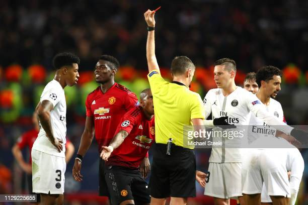 Paul Pogba of Manchester United is shown a red card during the UEFA Champions League Round of 16 First Leg match between Manchester United and Paris...