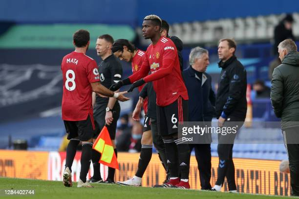 Paul Pogba of Manchester United is substituted on for Juan Mata of Manchester United during the Premier League match between Everton and Manchester...