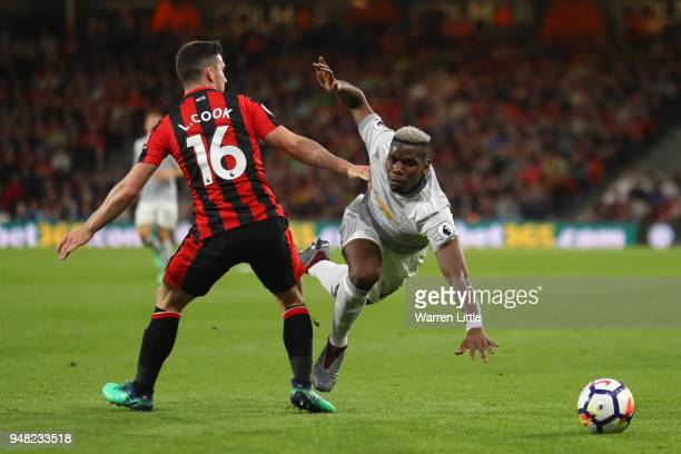 Paul Pogba of Manchester United is tackled by Lewis Cook of AFC Bournemouth during the Premier League match between AFC Bournemouth and Manchester...