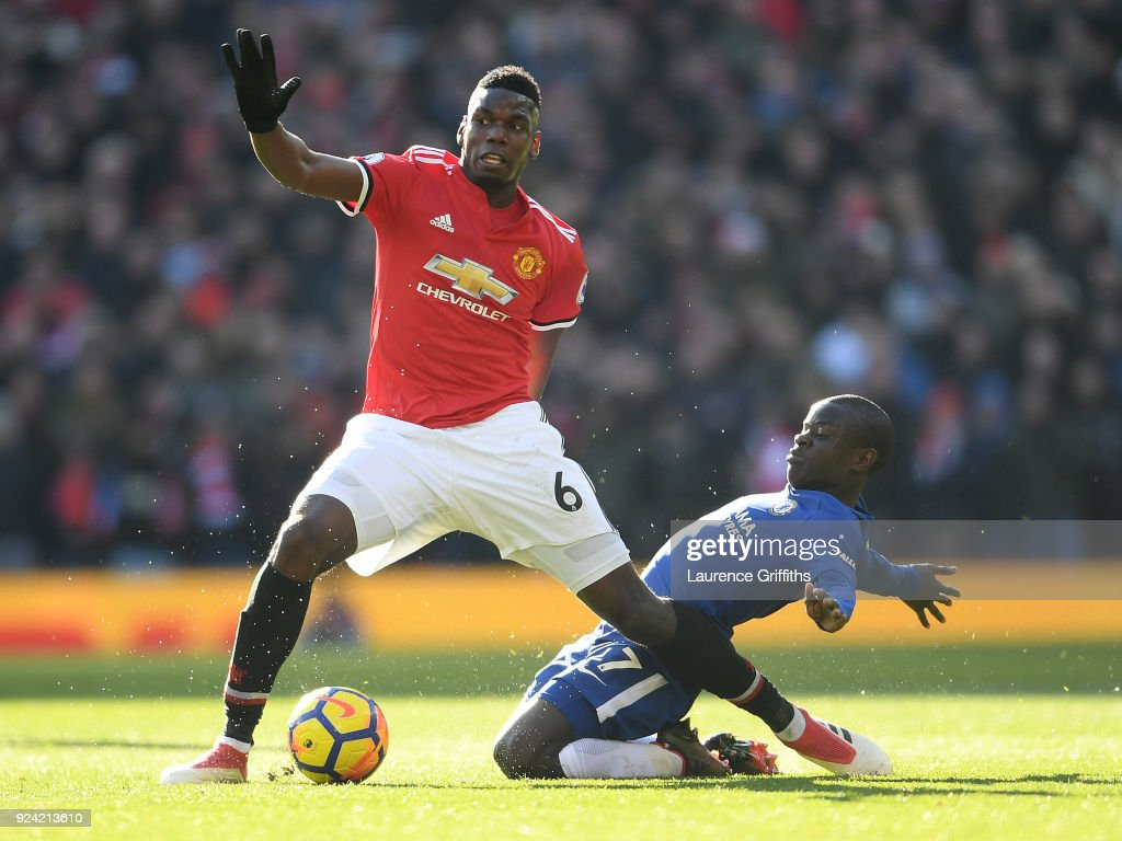 Paul Pogba of Manchester United is tackled by N'Golo Kante of Chelsea during the Premier League match between Manchester United and Chelsea at Old Trafford on February 25, 2018 in Manchester, England.
