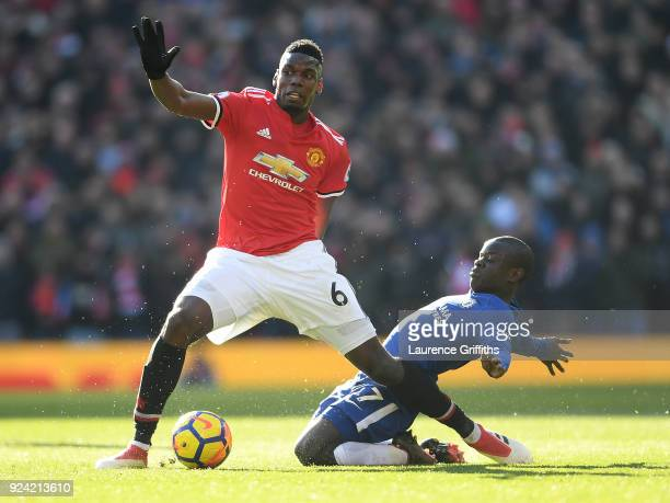 Paul Pogba of Manchester United is tackled by N'Golo Kante of Chelsea during the Premier League match between Manchester United and Chelsea at Old...