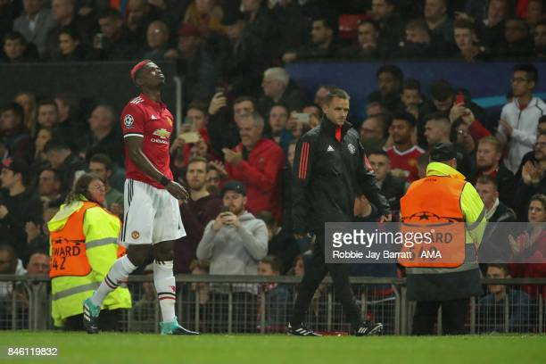 Paul Pogba of Manchester United leaves the game with a hamstring injury during to the UEFA Champions League match between Manchester United and FC...
