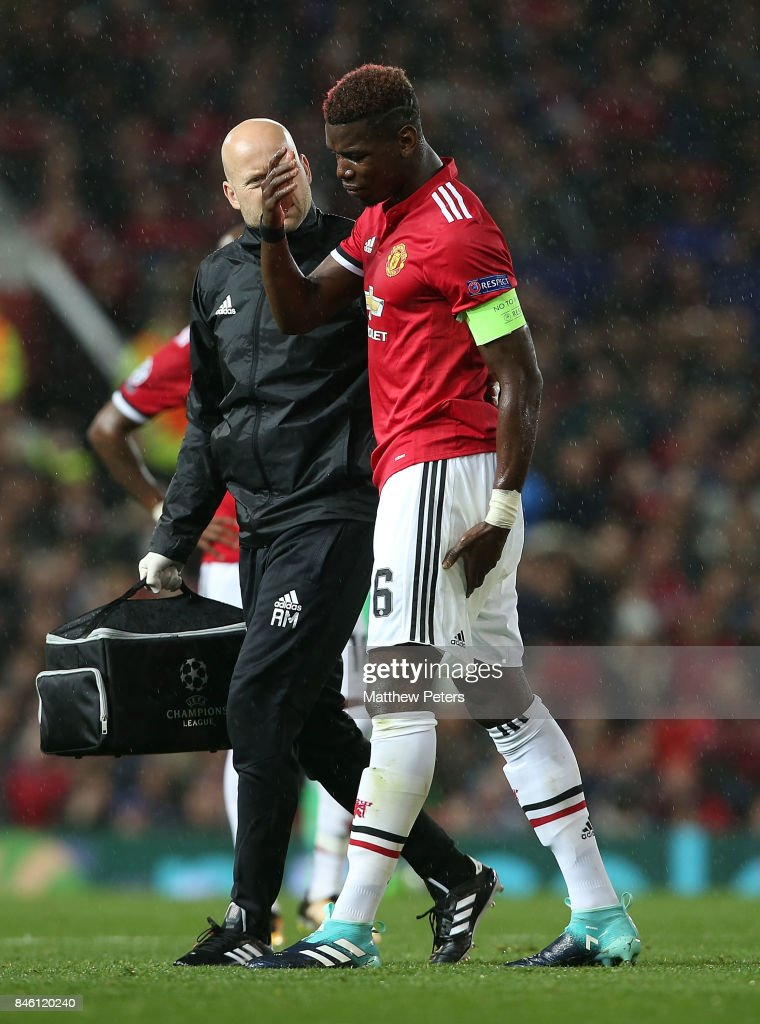 Paul Pogba of Manchester United leaves the match with an injury during the UEFA Champions League group A match between Manchester United and FC Basel at Old Trafford on September 12, 2017 in Manchester, United Kingdom.