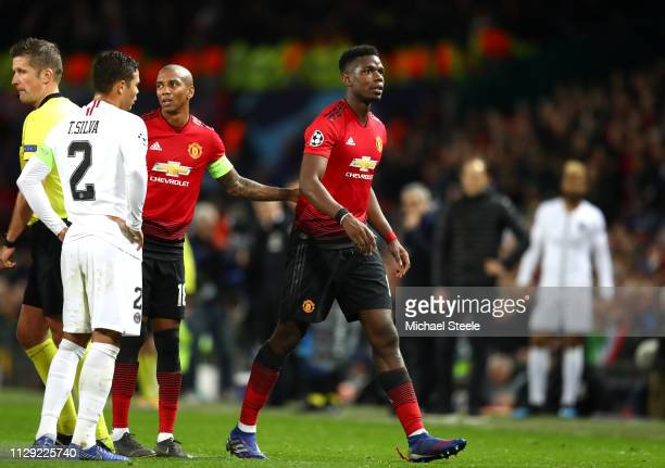 Paul Pogba of Manchester United leaves the pitch after he is shown a red card during the UEFA Champions League Round of 16 First Leg match between...