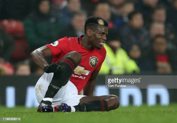 Paul Pogba of Manchester United lies injured during the Premier League match between Manchester United and Newcastle United at Old Trafford on...