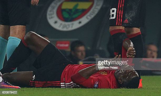 Paul Pogba of Manchester United lies injured during the UEFA Europa League match between Manchester United and Fenerbahce at sukru Saracoglu Stadium...