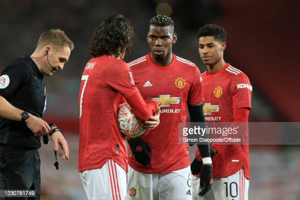 Paul Pogba of Manchester United looks at Edinson Cavani of Manchester United as Marcus Rashford of Manchester United stands by during The Emirates FA...