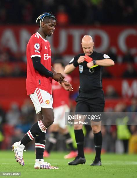 Paul Pogba of Manchester United looks dejected after being shown a red card by Match Referee, Anthony Taylor during the Premier League match between...