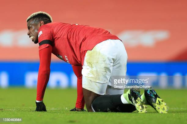 Paul Pogba of Manchester United looks dejected during the Carabao Cup Semi Final match between Manchester United and Manchester City at Old Trafford...