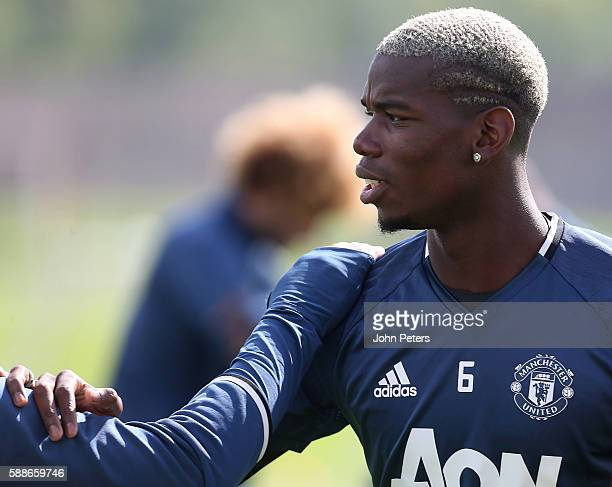 Paul Pogba of Manchester United looks on during a first team training session at Aon Training Complex on August 12 2016 in Manchester England