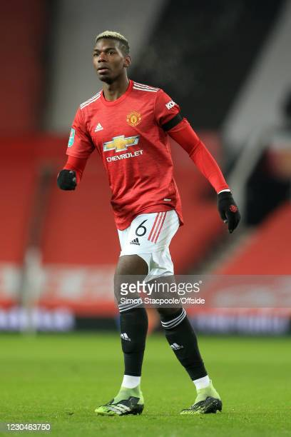 Paul Pogba of Manchester United looks on during the Carabao Cup Semi Final match between Manchester United and Manchester City at Old Trafford on...