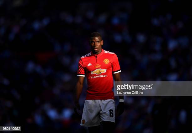 Paul Pogba of Manchester United looks on during The Emirates FA Cup Final between Chelsea and Manchester United at Wembley Stadium on May 19 2018 in...