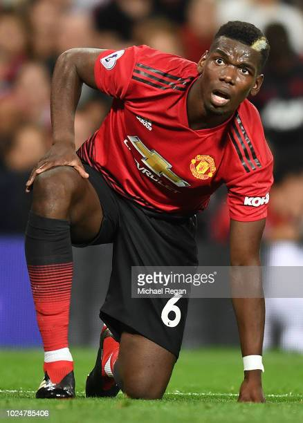 Paul Pogba of Manchester United looks on during the Premier League match between Manchester United and Tottenham Hotspur at Old Trafford on August 27...