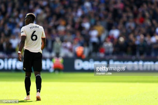 Paul Pogba of Manchester United looks on during the Premier League match between West Ham United and Manchester United at London Stadium on September...