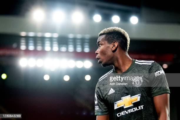 Paul Pogba of Manchester United looks on during the Premier League match between Liverpool and Manchester United at Anfield on January 17, 2021 in...