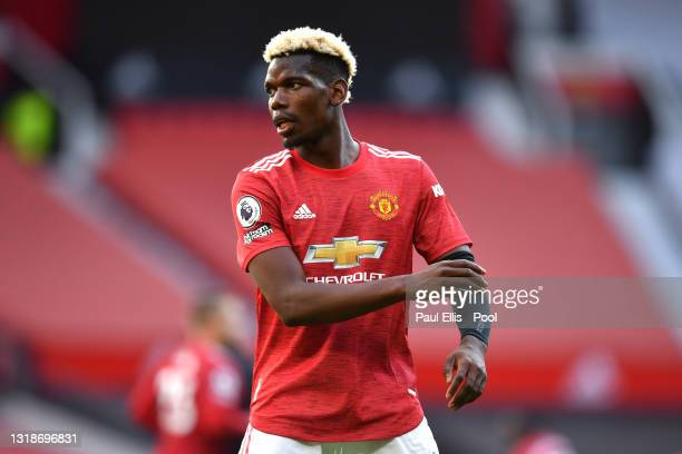 Paul Pogba of Manchester United looks on during the Premier League match between Manchester United and Fulham at Old Trafford on May 18, 2021 in...