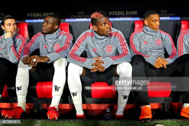Paul Pogba of Manchester United looks on from the substitute's bench ahead of the UEFA Champions League Round of 16 First Leg match between Sevilla...