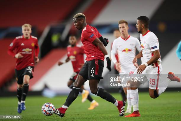 Paul Pogba of Manchester United passes the ball whilst under pressure from Benjamin Henrichs of RB Leipzig during the UEFA Champions League Group H...