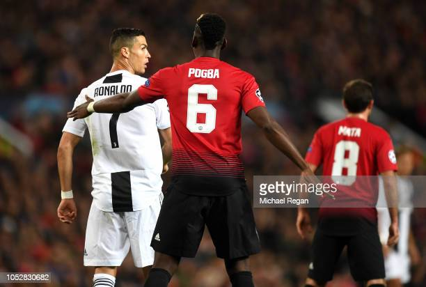 Paul Pogba of Manchester United pats Cristiano Ronaldo of Juventus on the back during the Group H match of the UEFA Champions League between...
