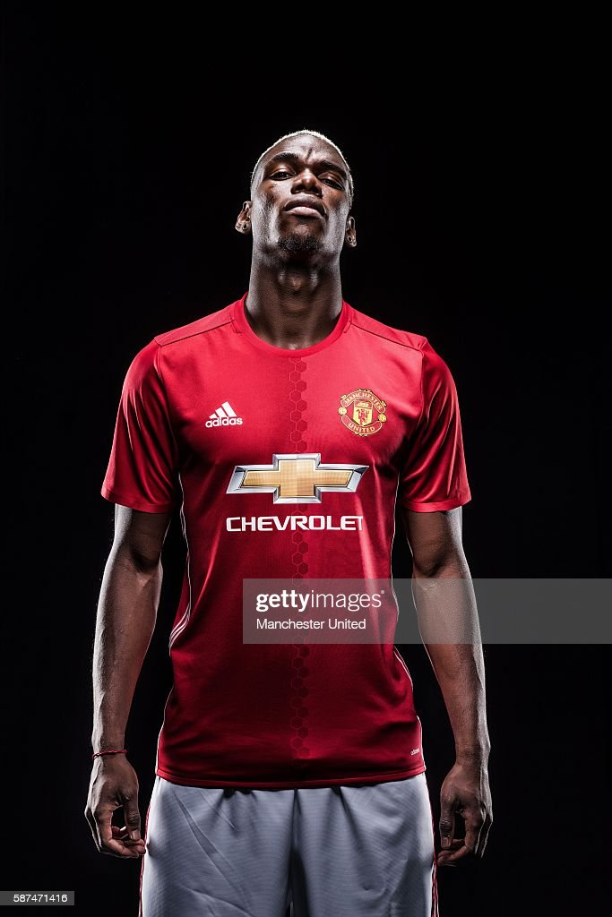 Paul Pogba of Manchester United poses after signing for the club at Aon Training Complex on August 8, 2016 in Manchester, England.