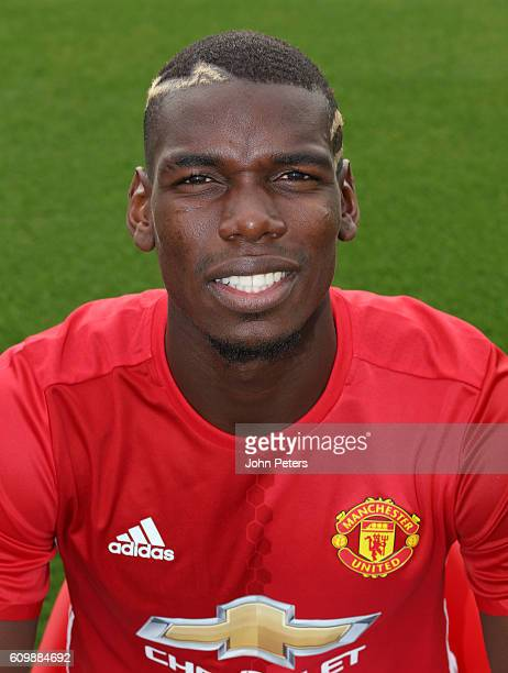 Paul Pogba of Manchester United poses for a portrait at the Manchester United Official Photocall on September 19 2016 in Manchester England