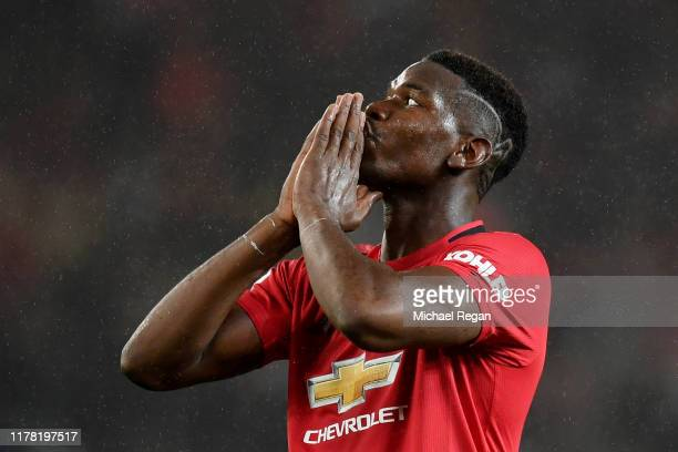 Paul Pogba of Manchester United reacts after missing a chance during the Premier League match between Manchester United and Arsenal FC at Old...