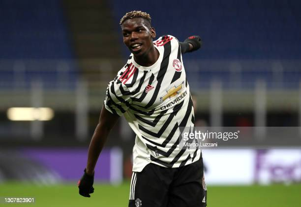 Paul Pogba of Manchester United reacts during the UEFA Europa League Round of 16 Second Leg match between AC Milan and Manchester United at San Siro...