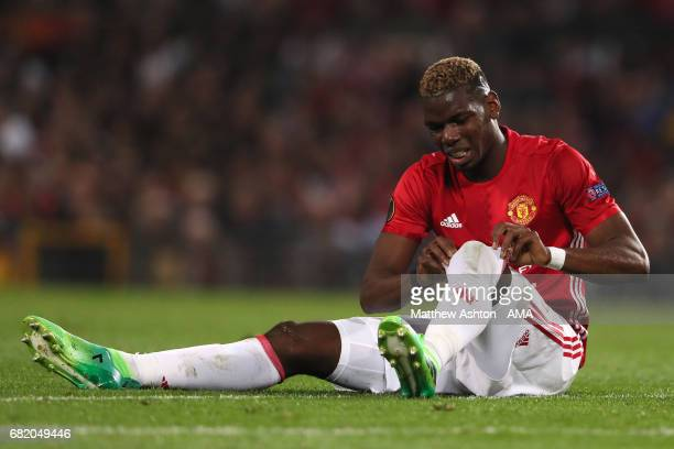 Paul Pogba of Manchester United reacts to a challenge during the UEFA Europa League semi final second leg match between Manchester United and Celta...