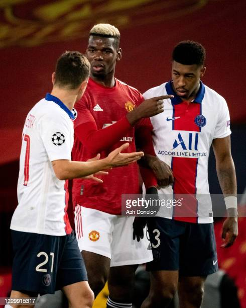 Paul Pogba of Manchester United reacts to Anger Herrera of Paris Saint-Germain during the UEFA Champions League Group H stage match between...