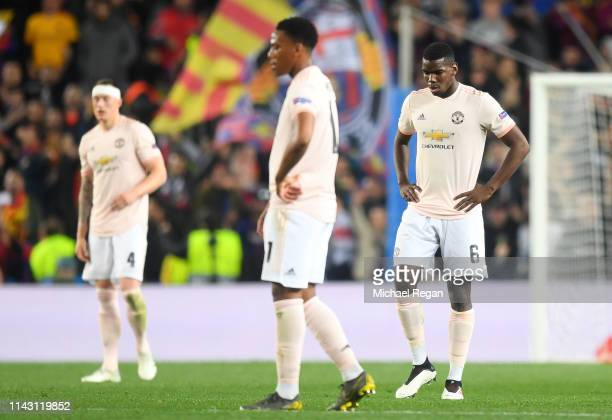 Paul Pogba of Manchester United reacts to Barcelona scoring there third goal during the UEFA Champions League Quarter Final second leg match between...