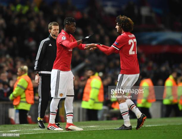 Paul Pogba of Manchester United replaces Marouane Fellaini of Manchester United as substitute during the UEFA Champions League Round of 16 Second Leg...